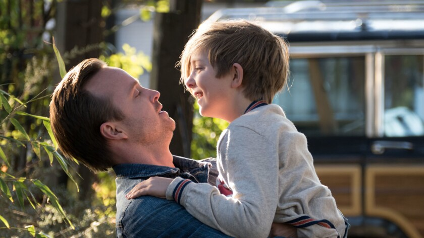 """Aaron Paul, left, and Aiden Longworth in the movie """"The 9th Life of Louis Drax."""""""