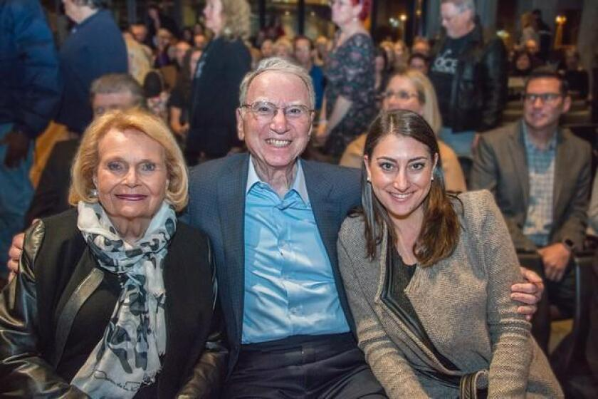 In the front row are Joan and Irwin Jacobs, major contributors to the Central Library, and their granddaughter, Sara Jacobs, now running for Congress in the 49th District.