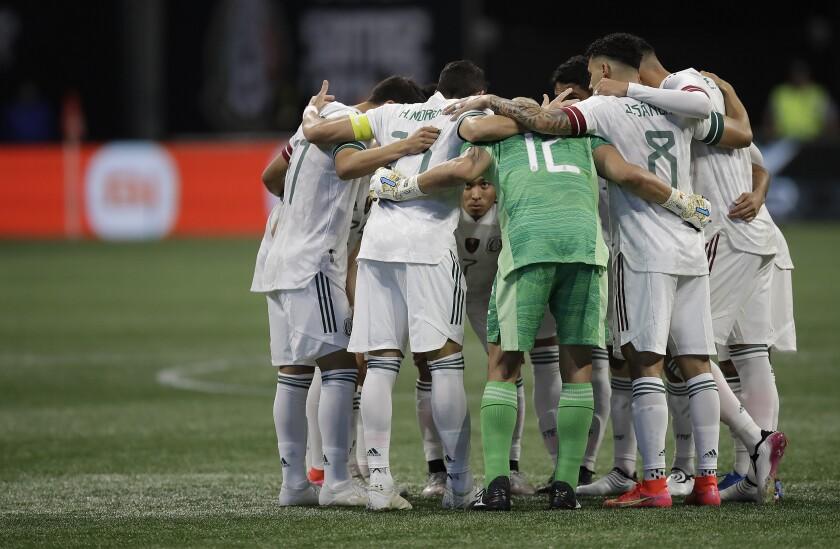 The Mexican soccer team huddles before facing Honduras on June 12.