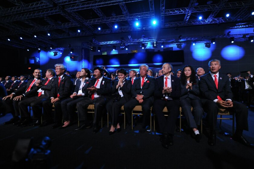 Kazahstan's delegation members sit together after Beijing was selected to host the 2022 Olympic Winter Games at IOC meeting during the 128th IOC session in Kuala Lumpur, Malaysia, Friday, July 31, 2015. The Chinese capital, which hosted the 2008 Summer Olympics, came in to the vote against the city from Kazakhstan as the strong favorite, despite its lack of natural snow. (Mohd Rasfan/Pool Photo via AP)