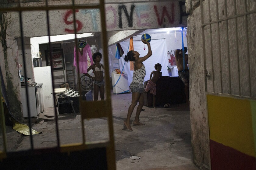 Residents play basketball at a squat known as Casa Nem in Rio de Janeiro.