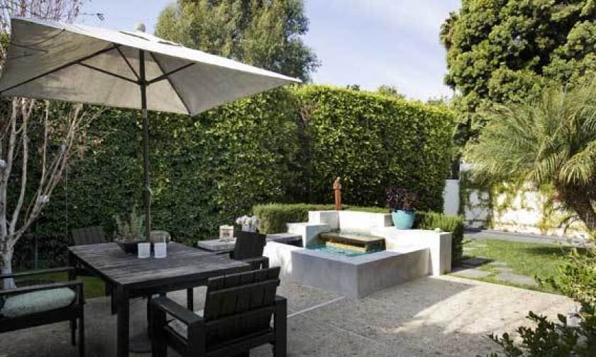 Selma Blair's gated property includes a patio area for outdoor dining and a koi pond.