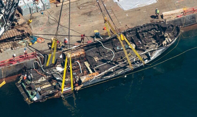 The burned hulk of the Conception is brought to the surface by a salvage team off Santa Cruz Island in the Santa Barbara Channel on Thursday.