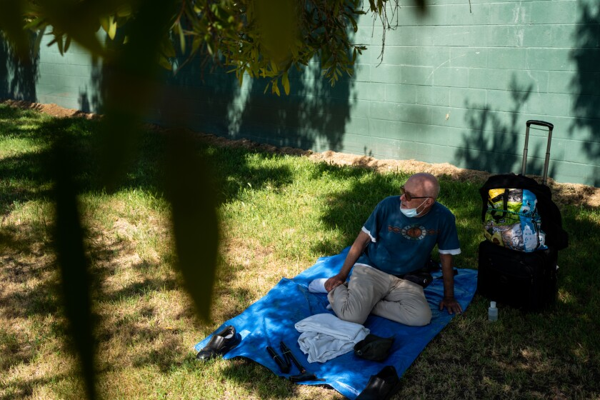 Terrance Whitten rests in the shade  at Pan Pacific Park on Friday in Los Angeles.