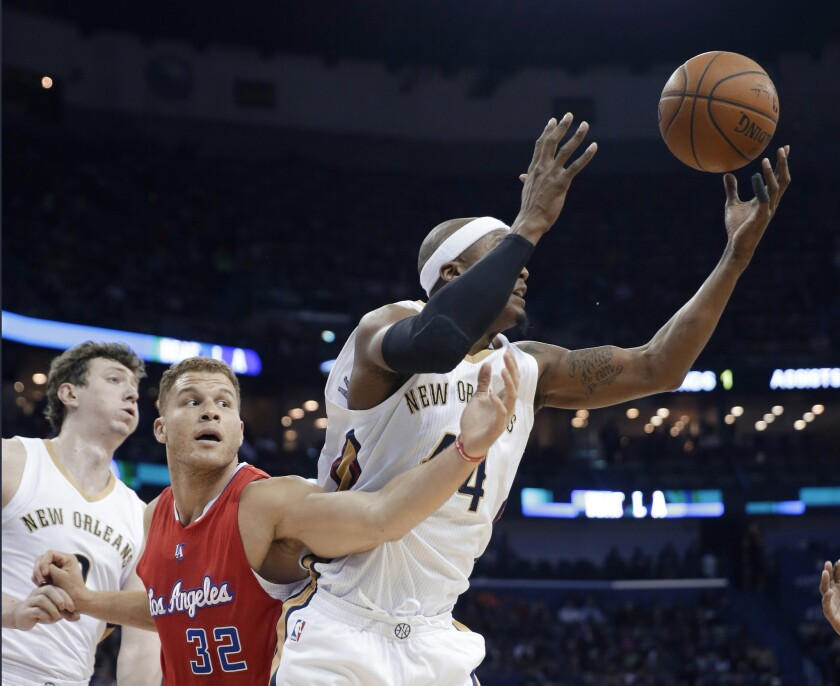 Clippers forward Blake Griffin looks to steal a rebound from Pelicans forward Dante Cunningham in the first half.