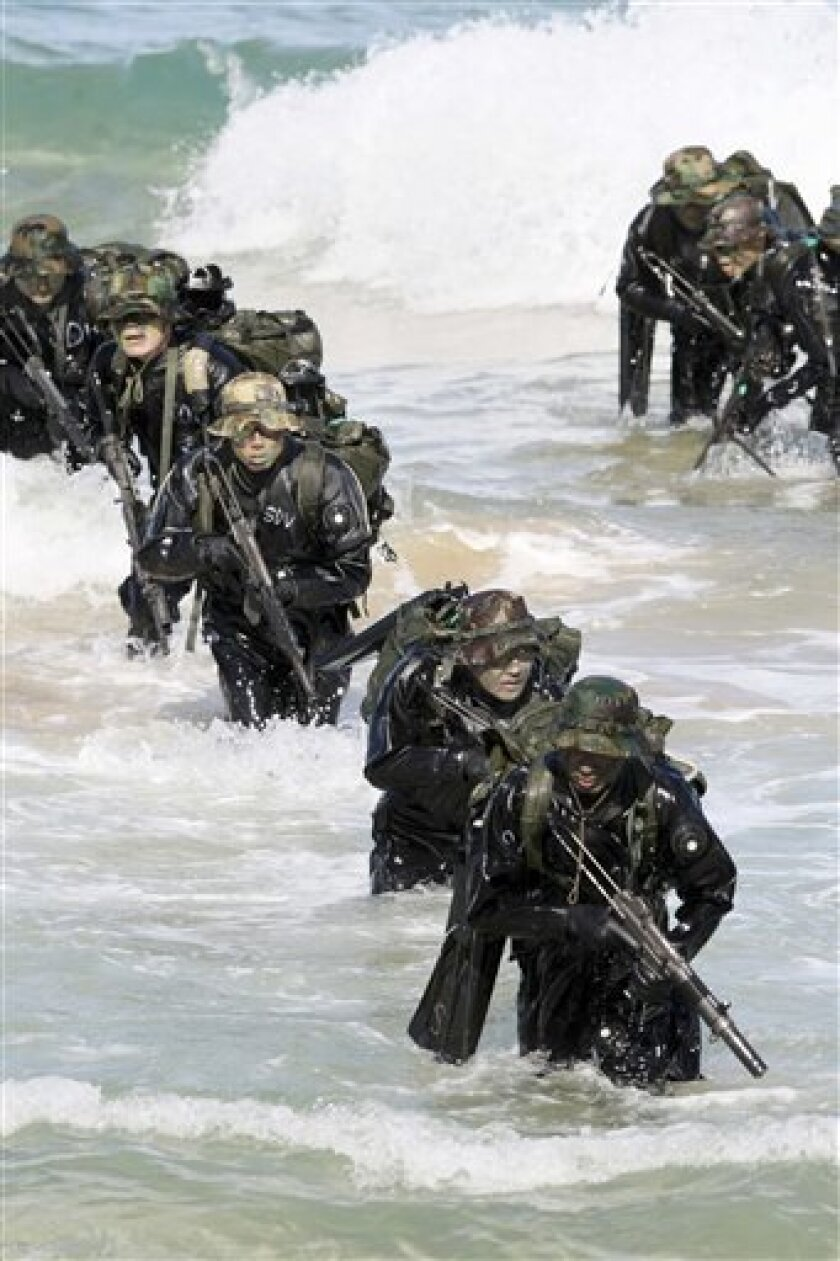 South Korean special military soldiers conduct a sea infiltration exercise in Donghae, South Korea, Friday, Feb. 5, 2010. (AP Photo/Yonhap, Lee Sang-hack)