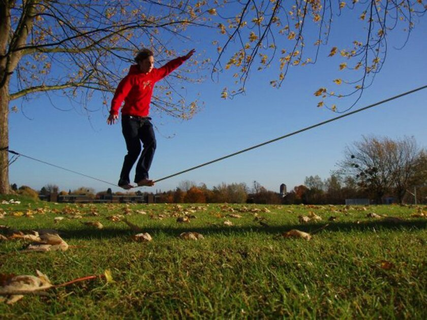 """Slacklining involves the use of a rope (typically flat nylon webbing) that is stretched between two anchor points for a person to balance on and/or perform acrobatic movements. According to San Diego Municipal Code, slacklining is prohibited in La Jolla areas for """"All beaches on the Pacific Ocean a"""