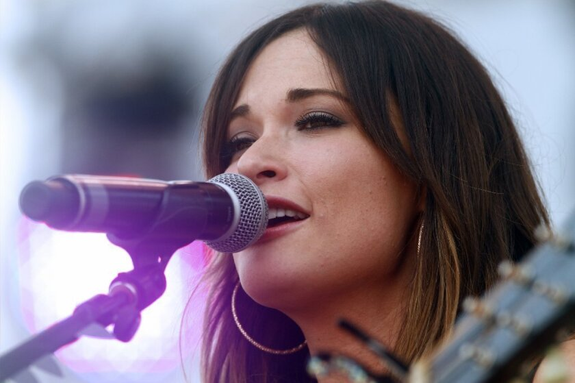 """Kacey Musgraves performs on Day 4 of the 2013 Bonnaroo Music and Arts Festival in Manchester, Tenn. Her recent album, """"Same Trailer Different Park,"""" is one of the best of 2013 so far."""