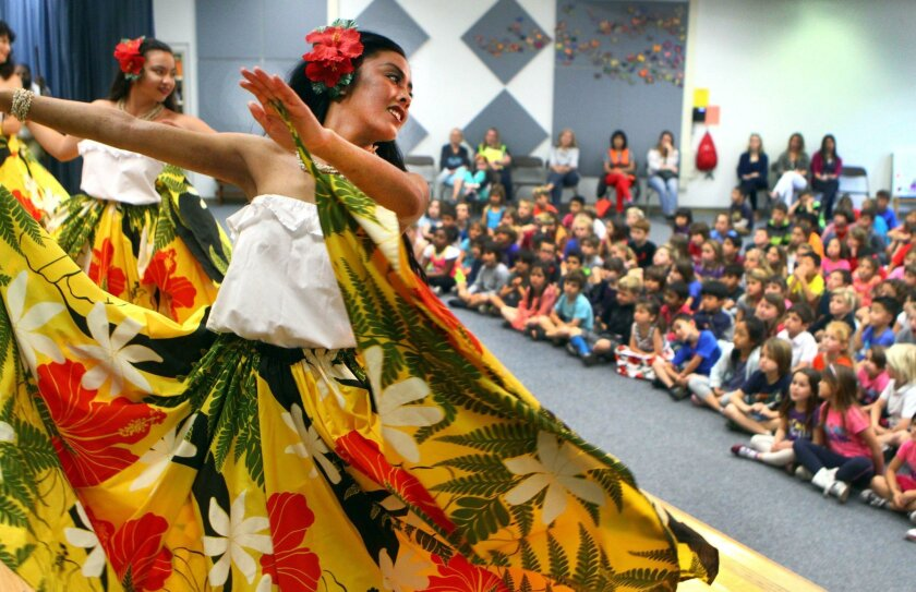 Marissa Lute, 20, performs a traditional Chamorro dance with the troupe Uno Hit on Feb. 12 at Del Mar Heights Elementary School during a three-week study of the Chamorro culture at the school.