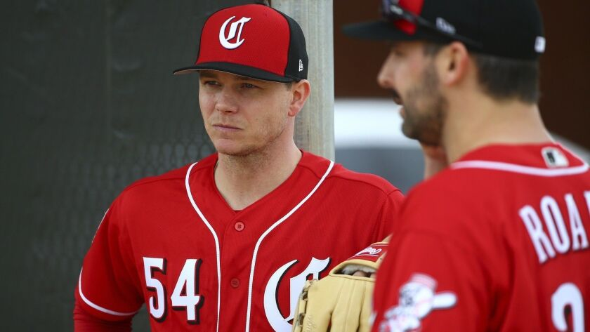 Cincinnati Reds pitcher Sonny Gray (54) and Tanner Roark pause during workouts at the Reds spring training baseball facility, in Goodyear, Ariz. Gray agreed to a trade from the Yankees after deciding he wanted to be part of the Reds' attempt at a resurgence.
