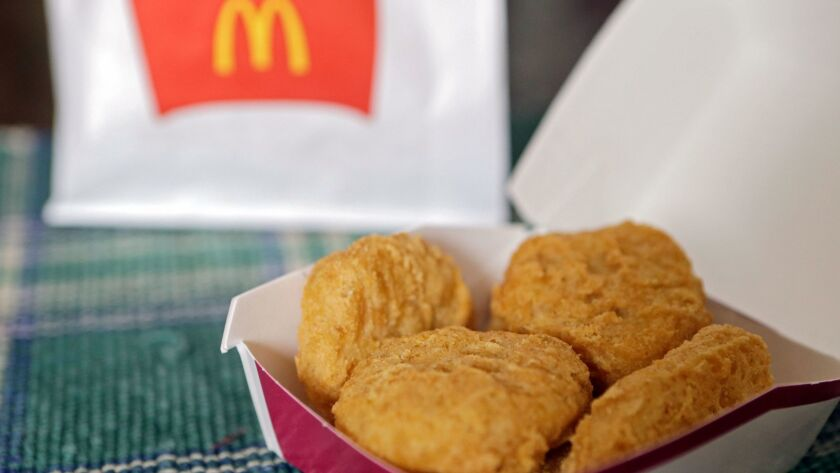 FILE - In this March 4, 2015 file photo, an order of McDonald's Chicken McNuggets is displayed for a