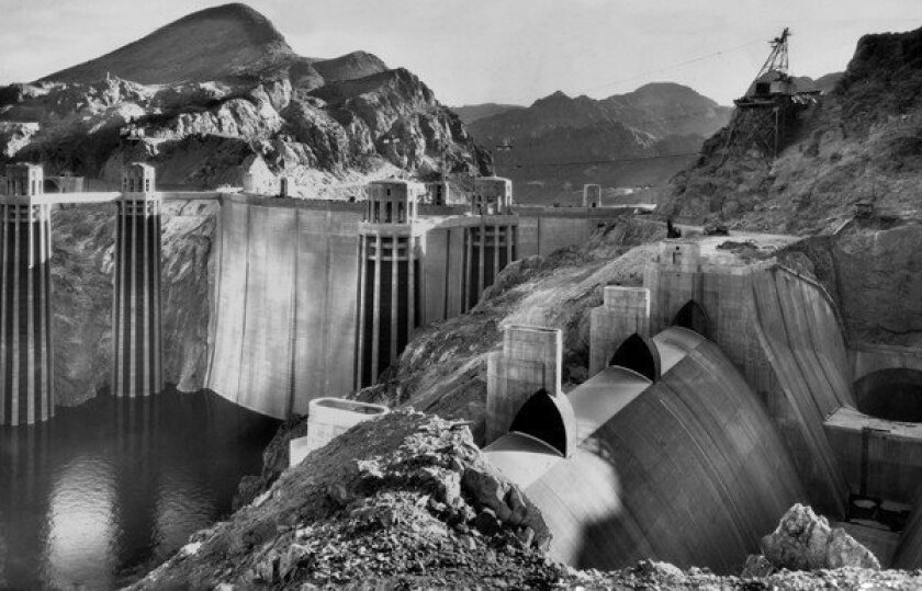 The Hoover Dam, seen in 1935, is a good example of the government taking a broad economic view and solving two problems with one project relatively inexpensively, Michael Hiltzik writes. The Internet is another example of the government's broad view.
