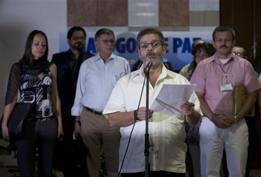 Marco Leon Calarca, member of the Revolutionary Armed Forces of Colombia, or FARC, talks to reporters during the continuation of peace talks with Colombia's government, in Havana, Cuba, Monday, Feb. 4, 2013. (AP Photo/Ramon Espinosa)