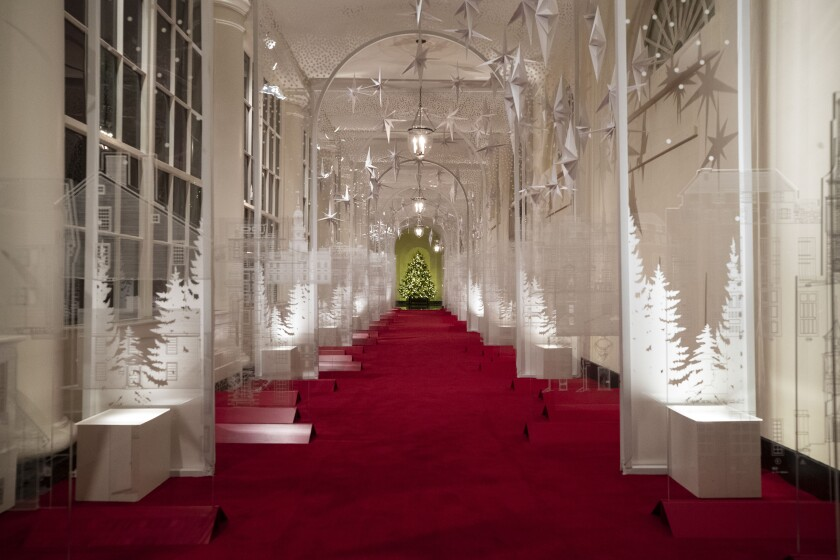 "The East Colonnade is decorated with a timeline of American design, innovation and architecture during the 2019 Christmas preview at the White House, Monday, Dec. 2, 2019, in Washington. This year's theme is, ""The Spirit of America."" (AP Photo/Alex Brandon)"