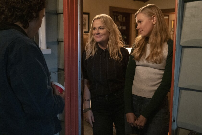 """Nico Hiraga, from left, Amy Poehler and Hadley Robinson appear in a scene from """"Moxie,"""" debuting Wednesday on Netflix. (Colleen Hayes/Netflix via AP)"""