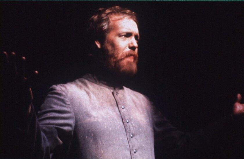 Robert Smyth as Father Damien.