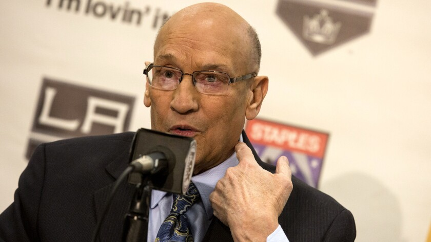 Kings announcer Bob Miller points to his carotid artery while explaining his health concerns as he announces his retirement on Thursday.