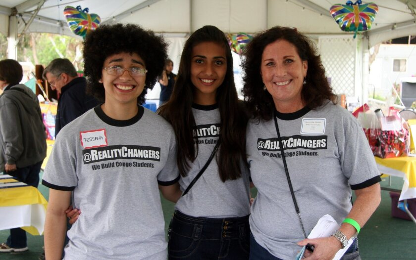 L-R: Reality Changers' youth attendees Tessalia Cooper and Stephanie Bueno, with Director Maureen Eberle, at the 2014 Del Mar/Solana Beach Rotary Turf Bocce Tournament, where they helped with the tournament. They also talked to participants about Reality Changers and its work. Courtesy photo