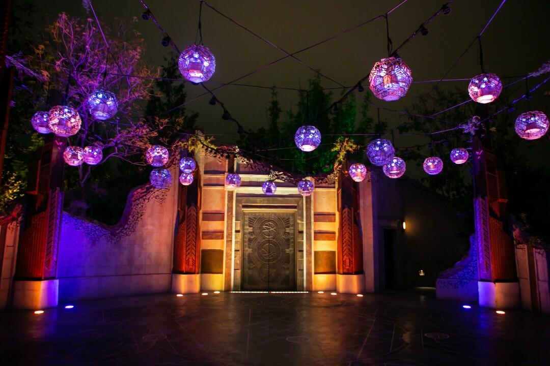 Purple lights hover over a doorway.