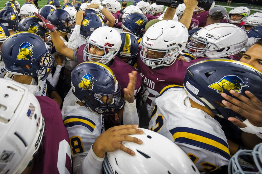 Players from Plano and El Paso Eastwood meet at midfield before their game on Sept. 5.