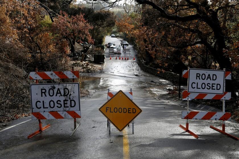 Rain triggers debris flows as storm rolls across fire-scarred
