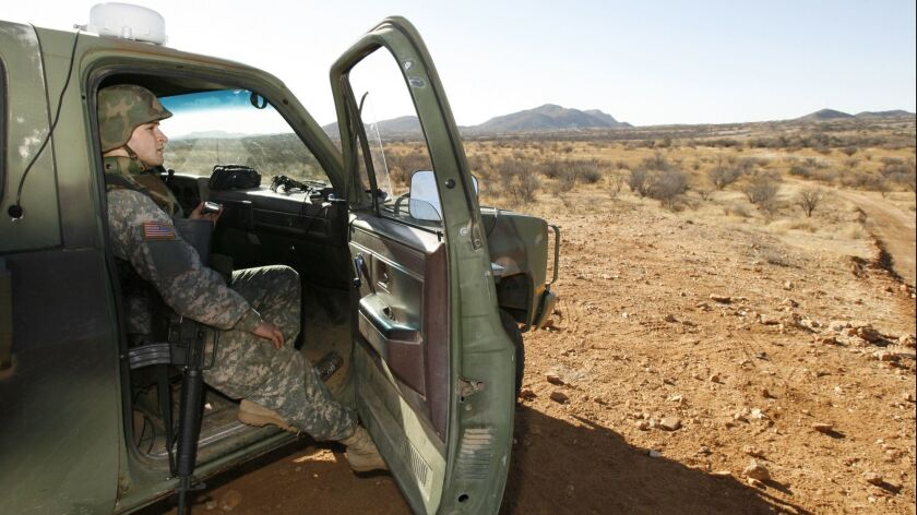 A National Guard unit patrolling at the U.S. border with Mexico in Sasabe, Ariz., in 2007.