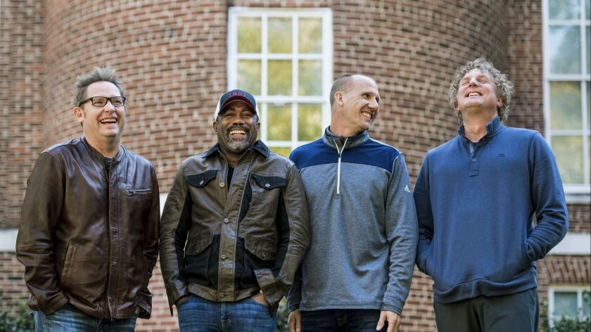 """Dean Felber, left, Darius Rucker, Jim Sonefeld and Mark Bryan of Hootie & the Blowfish. The band is returning with a tour and album 25 years after """"Cracked Rear View"""" launched the South Carolina-based rock band."""