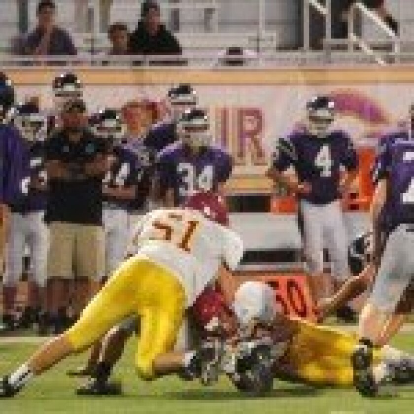 Michael Perrone makes a tackle in the backfield.