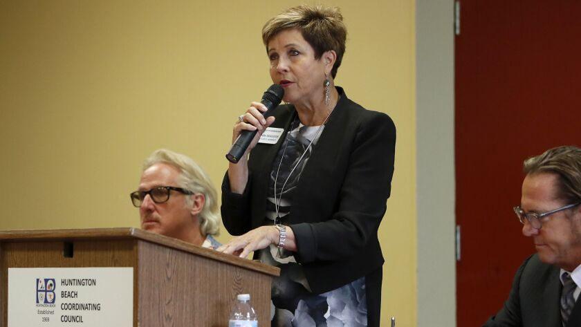 Barbara Delgleize speaks during a candidate forum at Murdy Park Recreational Center in Huntington Be