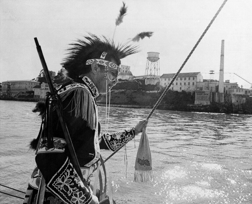 Adam Nordwall, 40, Chippewa, stands at the rail of the three-masted clipper Monte Cristo as it sails past Alcatraz Island in San Francisco Bay, Nov. 9, 1969.