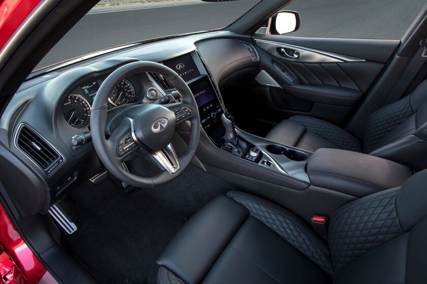 The driver area is cockpit-focused with a progressive order to the sweep of controls and switches.