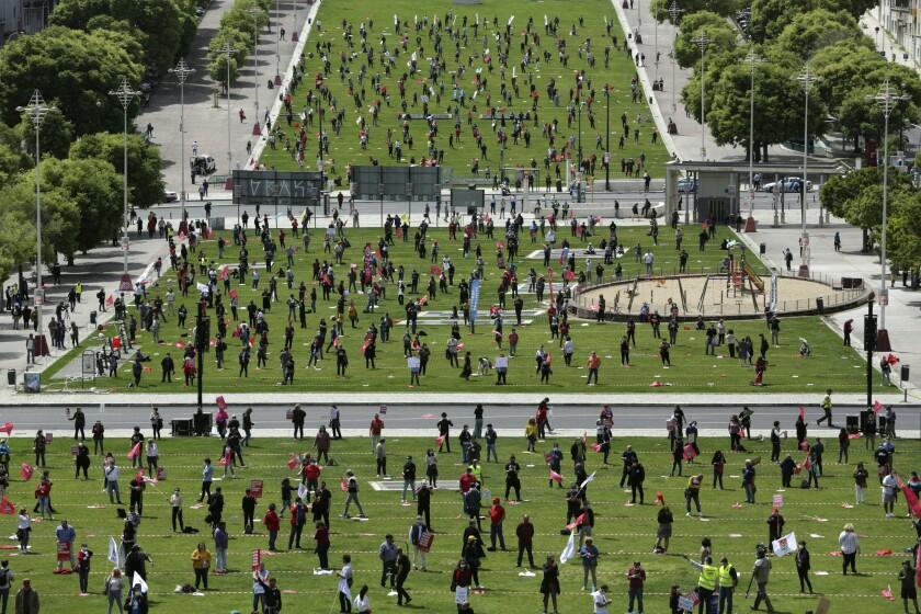 APTOPIX Virus Outbreak Portugal May Day