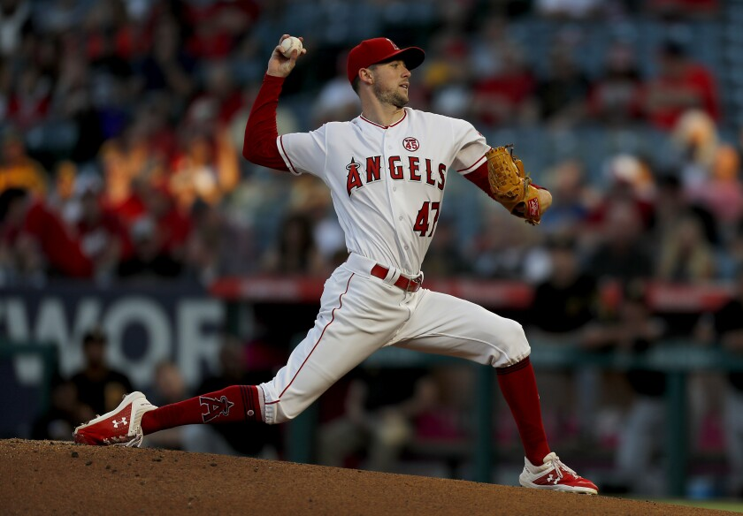 Angels starter Griffin Canning delivers a pitch against the Pittsburgh Pirates in the first inning on Aug. 13 at Angel Stadium.