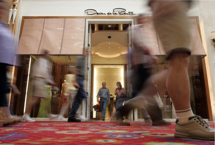 A new study challenges the view that the voices of the wealthy consistently drown out those of the poor. Instead, researchers say, Democratic elected officials side more with the views of low-income constituents while Republican lawmakers side more with their wealthier constituents. Above, shoppers outside the Oscar de la Renta store in Las Vegas.