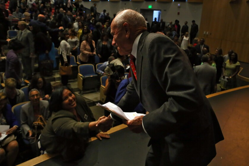 L.A. schools Supt. Ramon C. Cortines, right, greets school board member Monica Garcia after his annual address on Tuesday to administrators.
