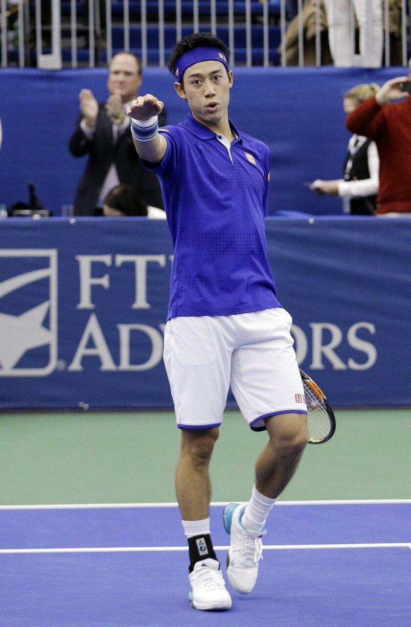 Kei Nishikori of Japan celebrates after beating Taylor Fritz of the United States in the singles championship at the Memphis Open tennis tournament Sunday, Feb. 14, 2016, in Memphis, Tenn. Nishikori won 6-4, 6-4. (AP Photo/Mark Humphrey)