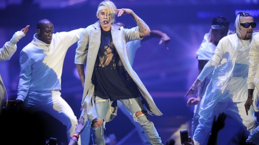 A woman was arrested on suspicion of trespassing after she allegedly walked into Justin Bieber's hotel room in Laguna Beach on Tuesday. The pop star is pictured in this file photo during a performance at Staples Center in 2016.