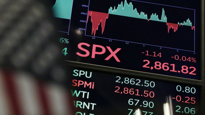 A board above the trading floor of the New York Stock Exchange shows the closing number for the S&P 500 index Wednesday, Aug. 22, 2018. The current bull run on Wall Street became the longest in history on Wednesday at 3,453 days.