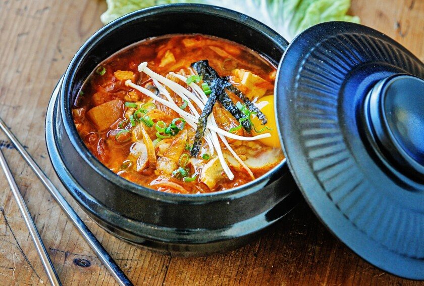 The savory stew Kimchi Jjigae, which showcases kimchi, includes silken tofu, pork belly, pork stock and aromatics.