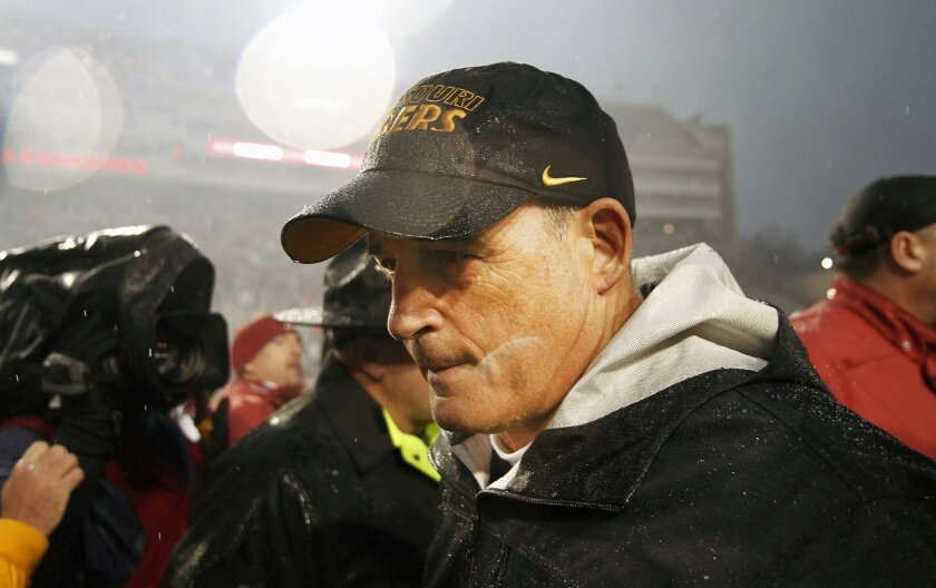 Missouri head coach Gary Pinkel leaves the field after an NCAA college football game against Arkansas, Friday, Nov. 27, 2015, in Fayetteville, Ark. (AP Photo/Samantha Baker)