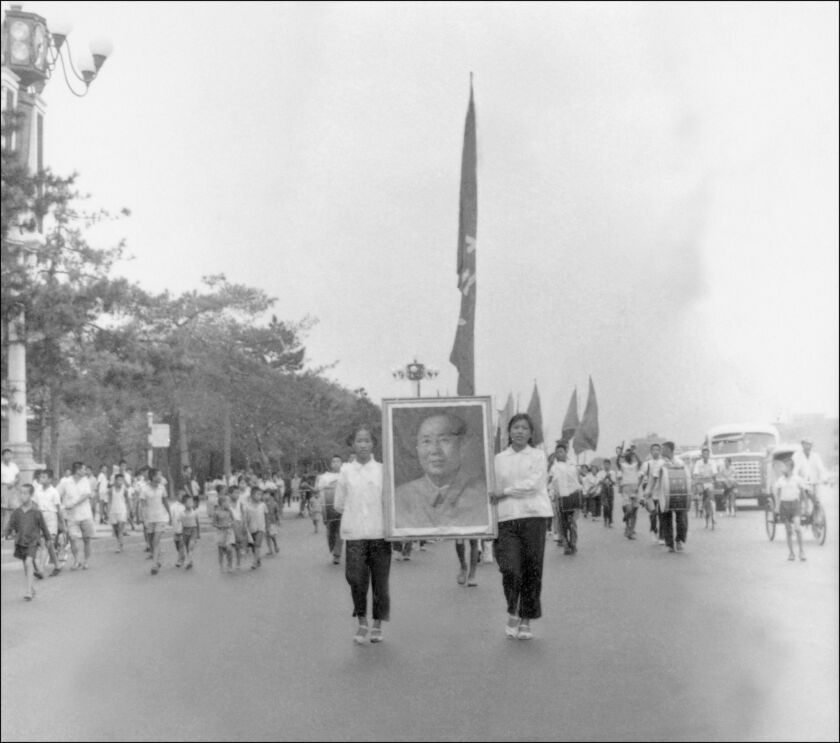 Red Guards carry a portrait of Chairman Mao Tse-tung as they parade on Beijing's Chang'an avenue in June 1966.