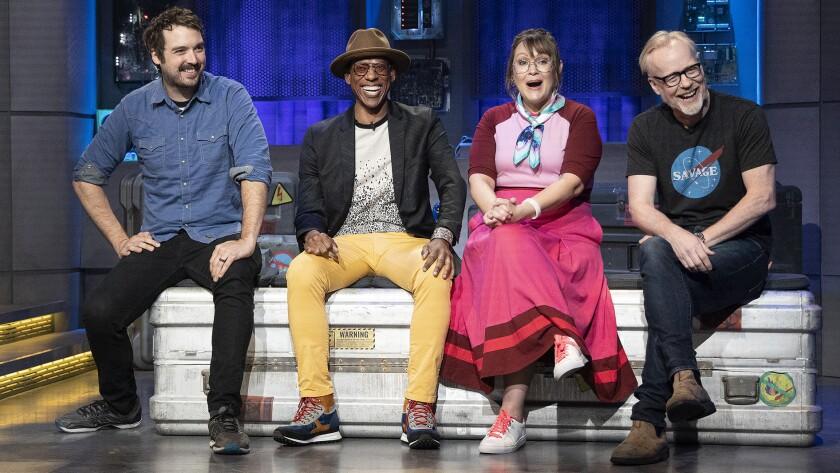 "Jonah Ray, left, Orlando Jones, Amber Nash and Adam Savage in ""The Great Debate"" on Syfy."