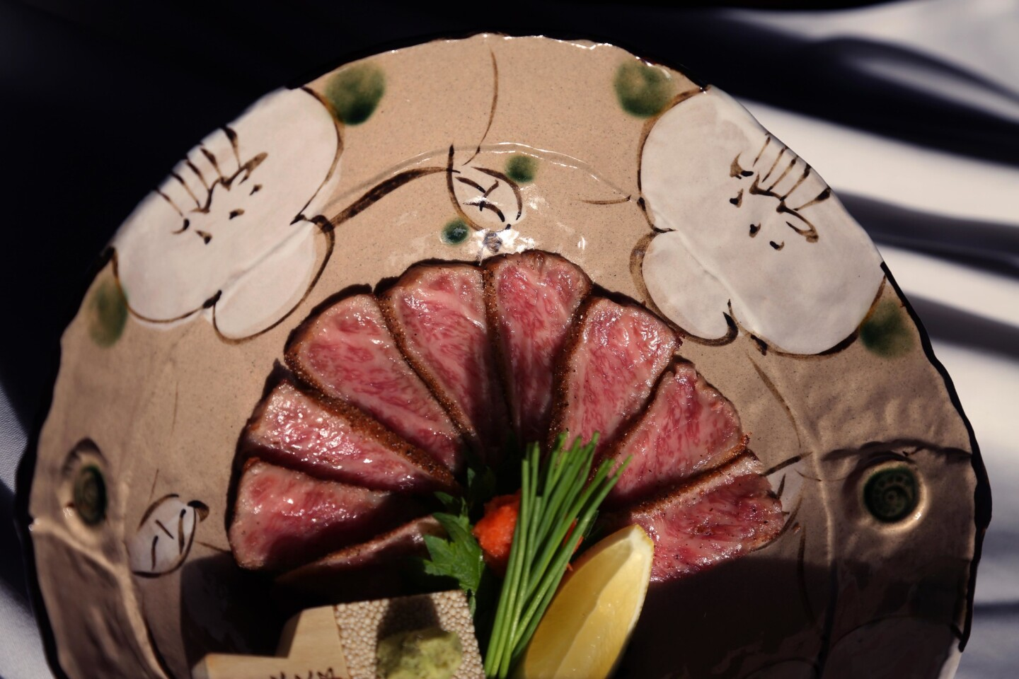 Wagyu beef tataki with fresh wasabi. The meat is lightly seared, marinated and sliced thinly, similar to sashimi.