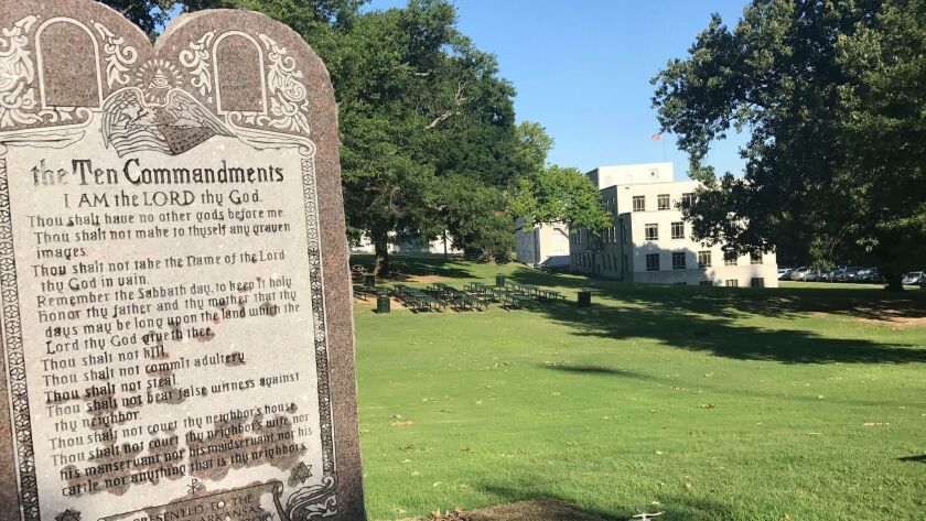 A monument engraved with the Ten Commandments was erected outside the Arkansas state Capitol Tuesday