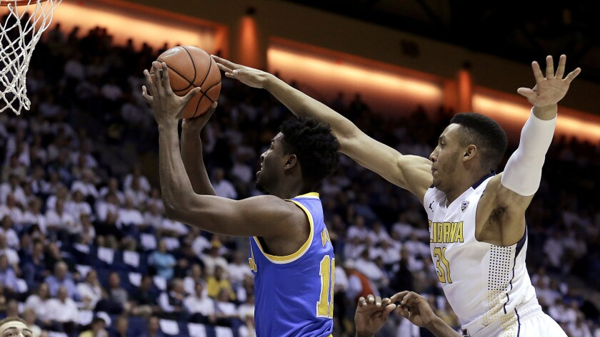 UCLA guard Isaac Hamilton gets past California guard Stephen Domingo for a layup in the first half Thursday night.