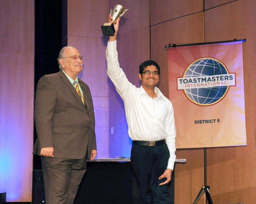 Prabhu Kandasamy celebrates his victory at the District 5 Toastmasters International Competition with district governor Mark Rauschenbach.