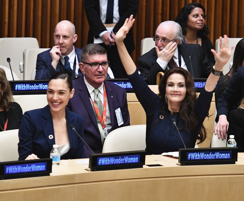 Wonder Woman in the upcoming self-titled film, Gal Gadot, and Wonder Woman in the 1970s hit TV show, Lynda Carter, celebrate as the character is recognized by the United Nations.