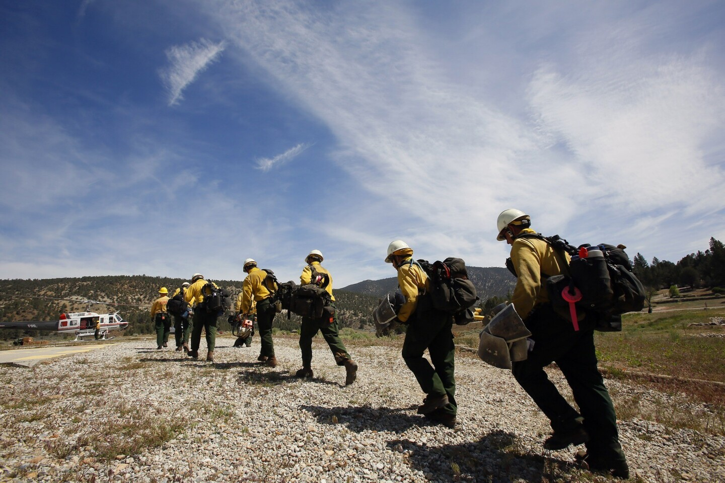 Members of the Bureau of Land Management's Kern Valley Hotshots board a helicopter at Chuchupate Ranger Station in Los Padres National Forest to be dropped high on top of mountains to fight the Grand fire. Firefighters continued battling the 3,500-acre brush fire in Kern County on Thursday morning. The fire started about 1 p.m. Wednesday near Frazier Park, and burned near the border with Los Angeles County. The fire was about 15% contained Thursday morning, officials said. The Los Angeles County Fire Department has sent about 180 personnel to assist in the firefighting effort, along with a helicopter, two bulldozers and two water tanker trucks.