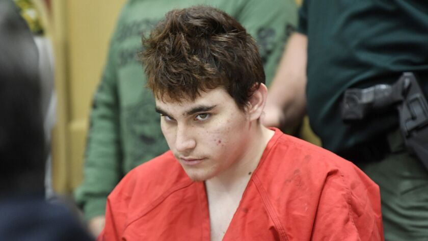 FILE - In this April 27, 2018 file photo, Florida school shooting suspect Nikolas Cruz, looks up whi