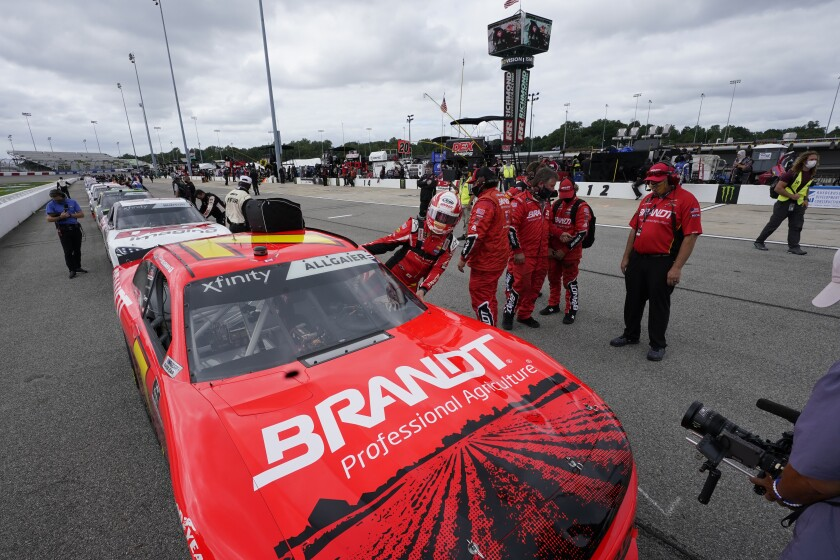 CORRECTS DATE TO SEPT. 12-Winner of last night's Xfinity race Justin Allgaier (7) gets in his car prior to the start of a NASCAR Xfinity Series auto race Saturday, Sept. 12, 2020, in Richmond, Va. (AP Photo/Steve Helber)